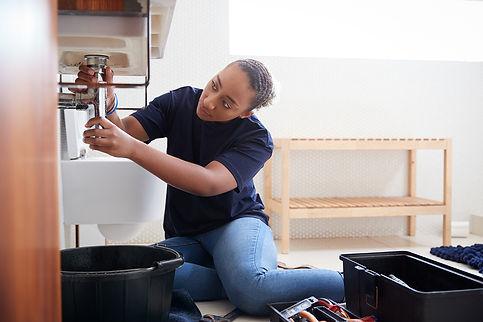 bigstock-Female-Plumber-Working-To-Fix--