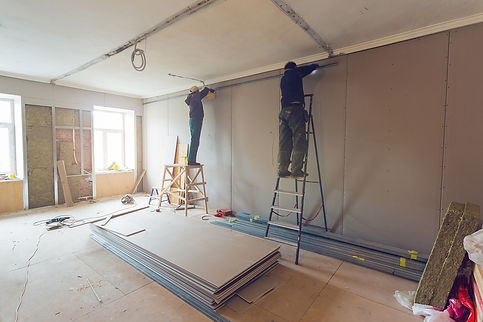 bigstock-Workers-Are-Installing-Plaster-