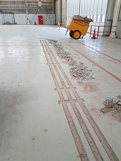 Long strips cut out of the floor.jpg