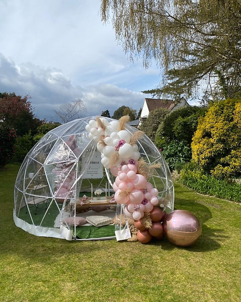 dome surrounded with a display of pink balloons.jpg