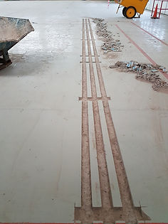 long straight strips cut out of a floor.jpg