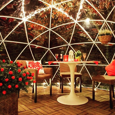 red flowers, cushions and candles inside a dome.jpg