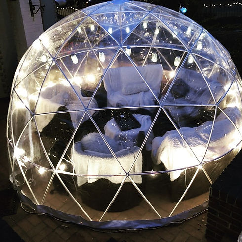 sofas covered in blankets inside a pvc dome.jpg