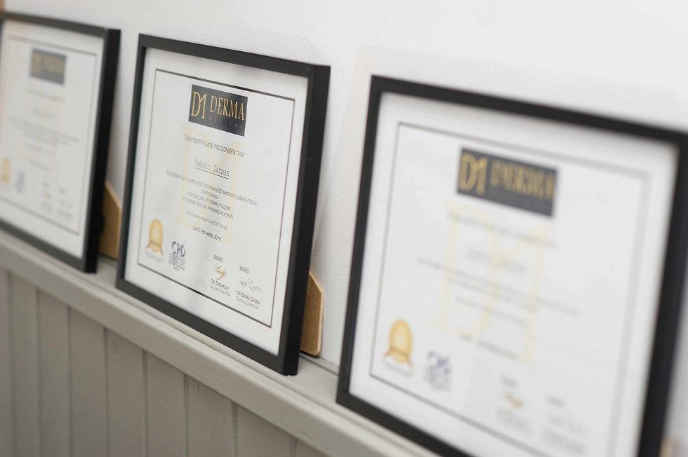 Certificates in frames along a wall.jpeg