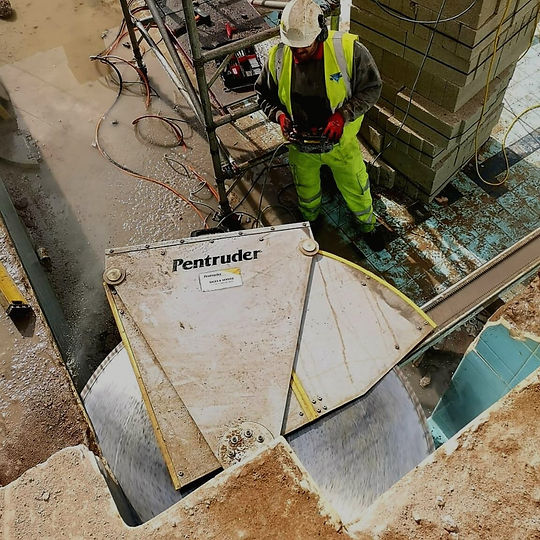 A high angle photo of a circular saw cutting into the corner of a wall