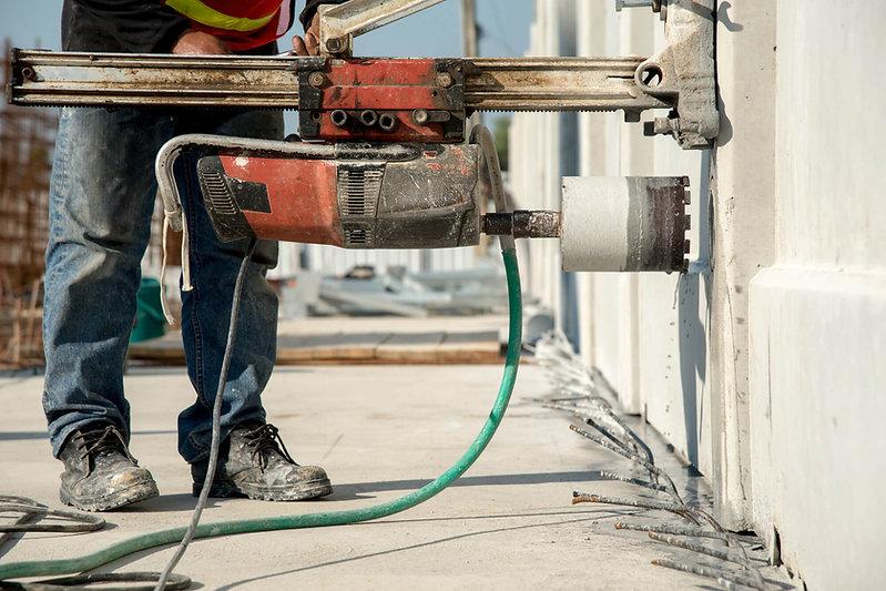Construction worker coring concrete.jpg
