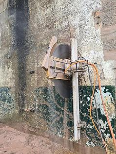 A circular saw cutting into a wall.jpg