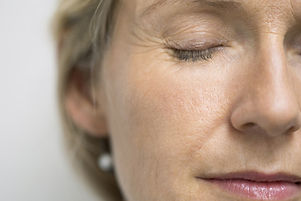 Close up of serene woman with eyes closed.jpg