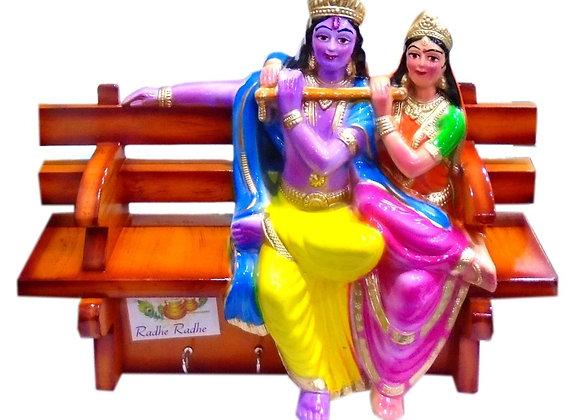 Today Fashion Key Holder Sitting Radha Krishna On Bench 11 inch, Random Color