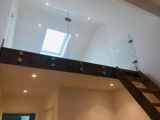 glass window and wooden stair case