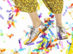 silver-shoes-dancing-through-confetti.jp