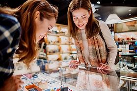 Women looking at merchandise_edited.jpg