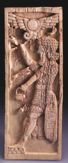 Nimrud Ivory Plaque with Bearded Warrior Holding Bucket and Pine Cone