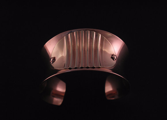 Corrugated brass on copper anticlastic cuff
