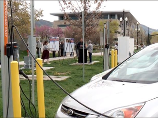 EV charging stations unveiled in conjunction with Community Renewable Energy Act signing