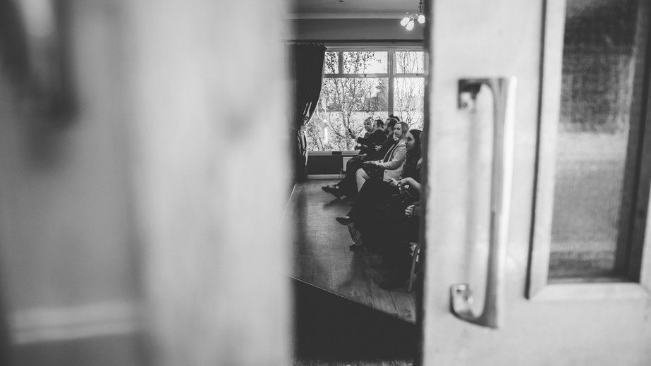 Sneak Peek of Guests waiting for Bride in Wedding Ceremony in Kent.