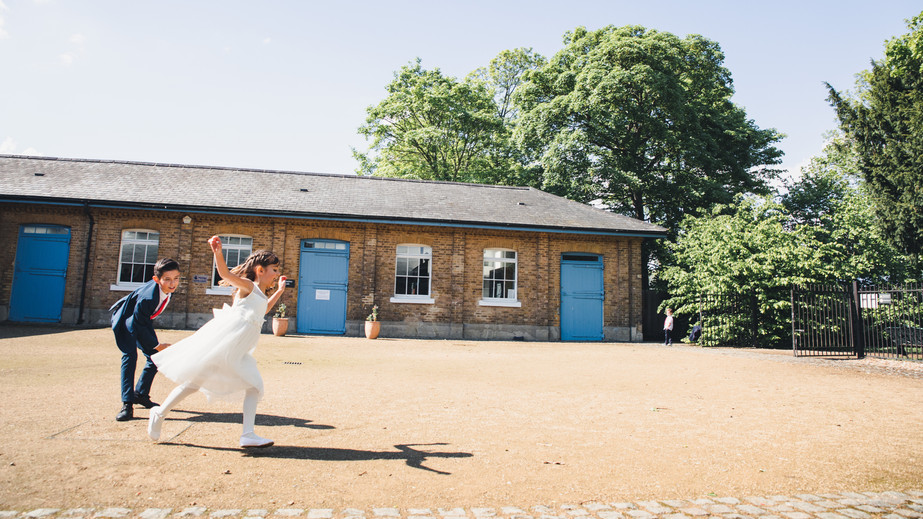 Flower girl and page boy playing in the courtyard at Orleans House Gallery
