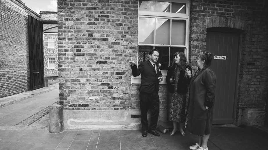 Wedding guests chatting in courtyard at Orleans House Gallery