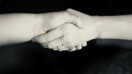 Helpijng hands working together (Credit