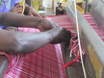 Cutting the cloth from the loom