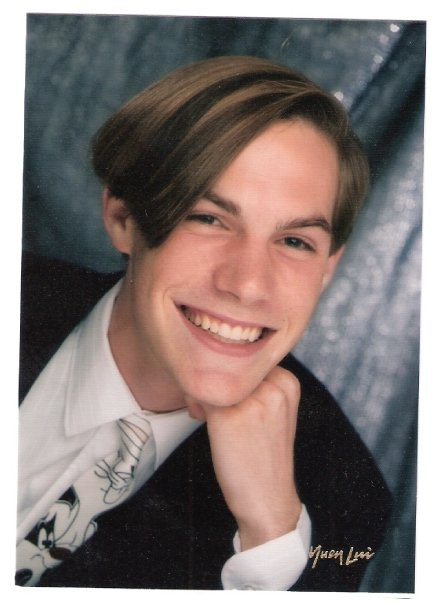 High school yearbook photo of an attractive young man