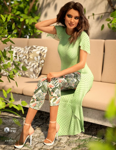 Image shows woman sitting outside on a couch, wearing dForce Pretty Stylish Outfit for Genesis 8 Female and playing with her hair.
