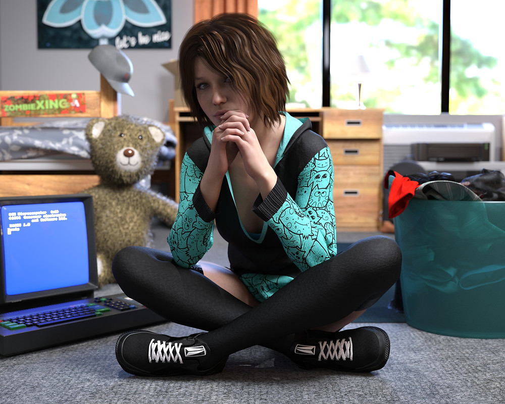 Young, modern, stylish woman sitting cross-legged next to a computer on the floor