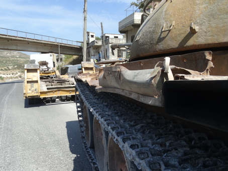 Exclusive photo essay: Heavy weapons withdrawn from DMZ in Idlib