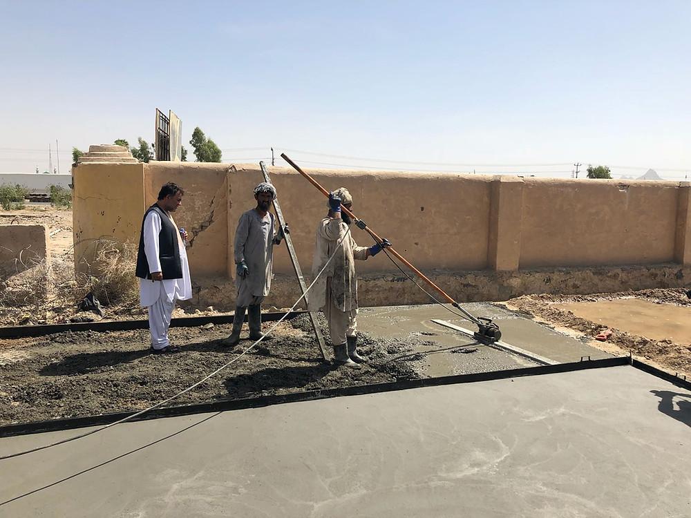 Afghan men construct a new park (UN Habitat)
