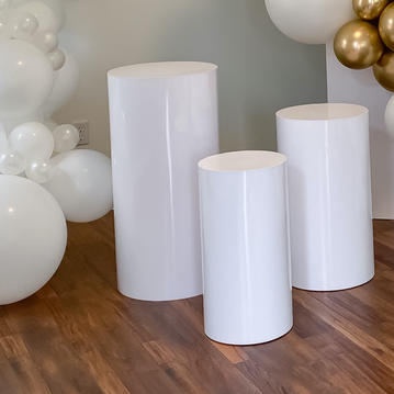 White Cylinder Stands/Tables - $150.00