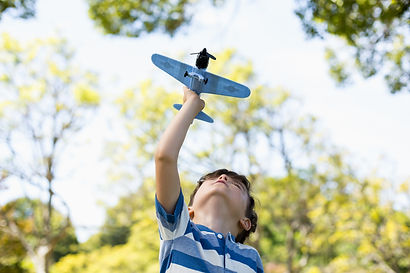 boy-playing-with-toy-aeroplane.jpg