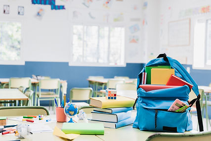 schoolbag-with-books-and-scattered-stati