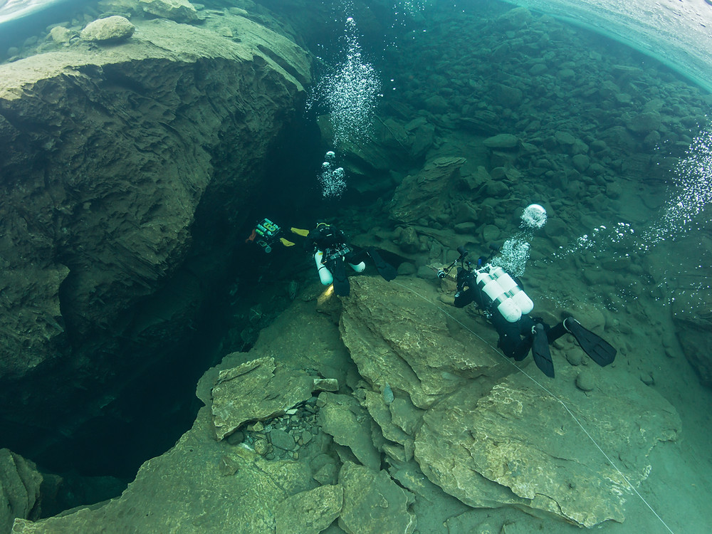 Cave divers entering the Plura cave system
