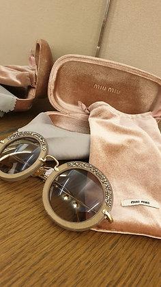 Miu Miu Diva sunglasses . Reveal beige