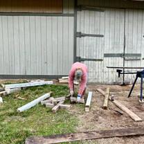 Kate Florshinger repairing jump poles.jpg