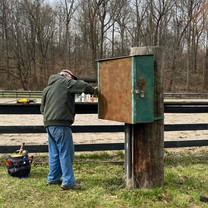 Jeremy sanding electrical box.jpg