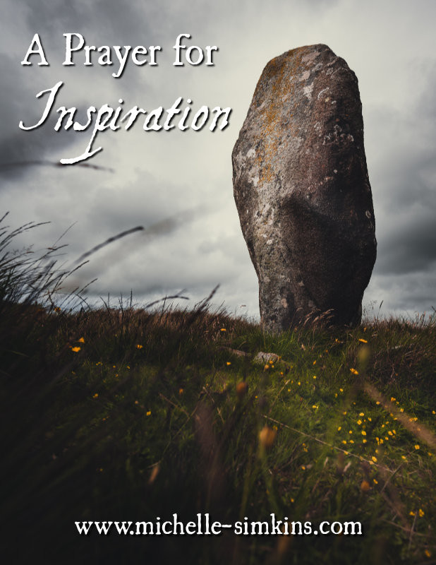 """Standing stone on a hill with flowers under a grey sky, with the words """"A Prayer for Inspiration"""""""
