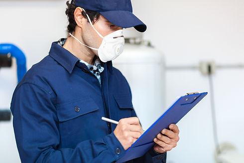 Plumber at work wearing a mask, coronavi