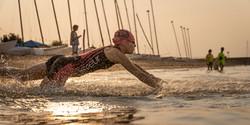 Triathlon swimmer diving in