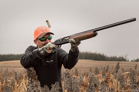 Pheasant hunter firing a shot