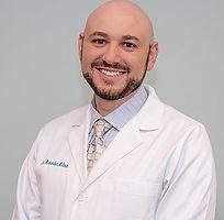 headshot of dr. alexander milman