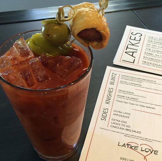 The Latke Love Bloody Mary -  spicy horseradish and tomato juice and yes that is a frank in a blanke