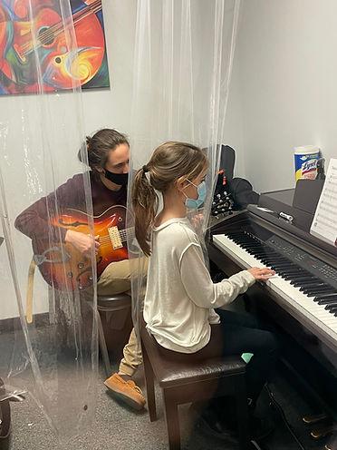 Mr. Kyle teaching piano to Livia