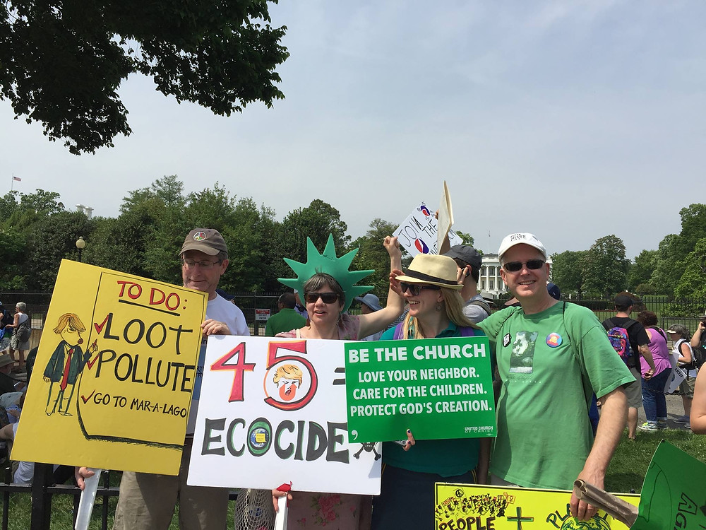 Our beloved band of Marchers showing our signs: Nate Yordon, me, Pam Arifian and Tim Hughes
