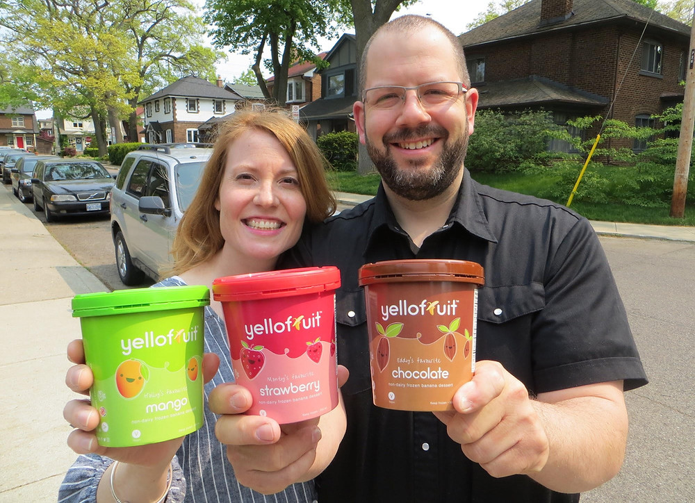 Andrew and Claire holding pints of Yellofruit