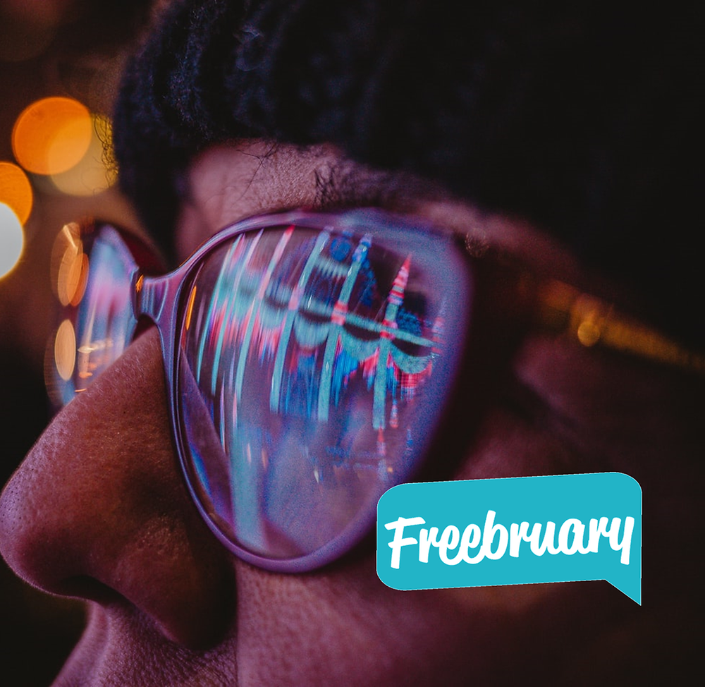 Freebruary Instagram Contest Image - Guy with glasses reflecting city lights