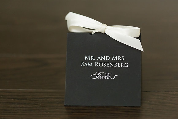 Black and ribboned place card