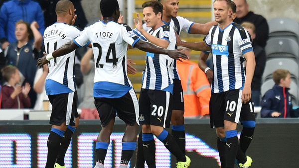 Thauvin receiving acclaim from his teammates. In the background is Jamaal Lascelles making his Newcastle debut in this match against Northampton. Picture courtesy of What Culture.