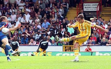 Ryan Taylor wrapping up the points with his 21st minute strike against Crystal Palace in September 2009. Wearing that awful custard cream/vomit striped shirt. Picture courtesy of The Telegraph.