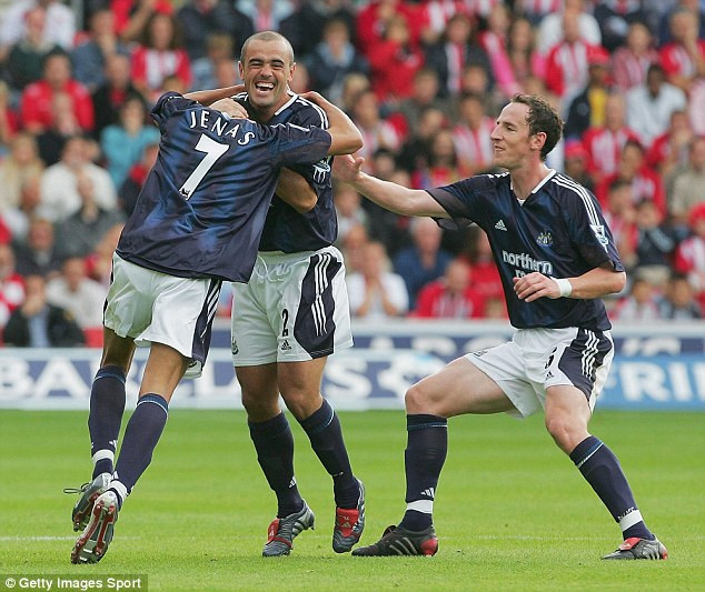Forget the goal, credit should go to the photographer on this one! Stephen Carr looks like he is beheading Jermaine Jenas with his bear hands and Andy O'Brien (right), try as he might, can't stop him.